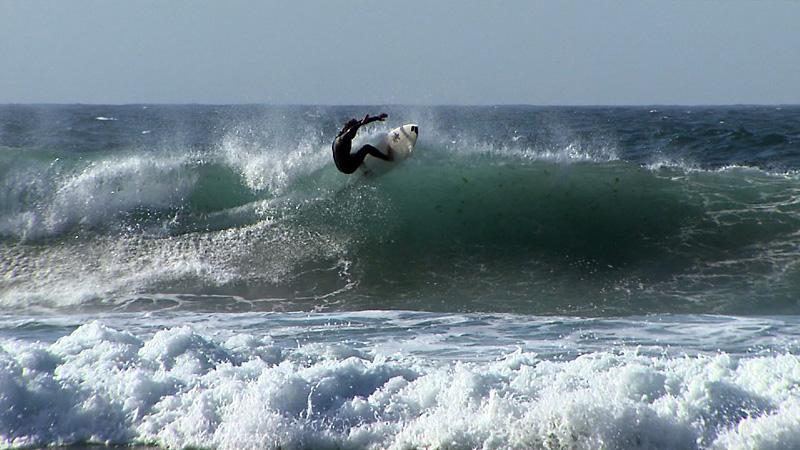 Surfista en la playa de As Salseiras